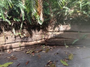 timber retaining wall that needs repair