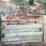 timber retaining wall mid construction sm