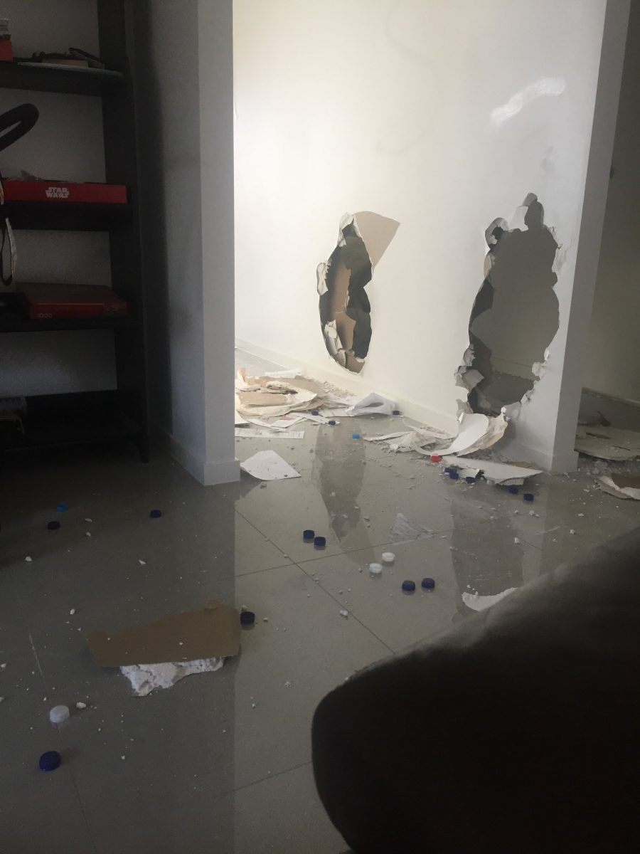 big hole in the plaster wall